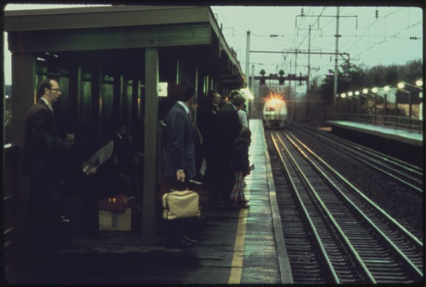PASSENGERS_WAITING_FOR_AN_AMTRAK_METROLINER_TRAIN_THAT_WILL_TAKE_THEM_FROM_A_WASHINGTON,_DISTRICT_OF_COLUMBIA,_SUBURB..._-_NARA_-_556673